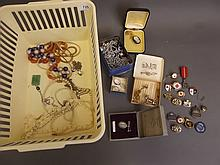 A quantity of costume jewellery to include a gold brooch, badges etc