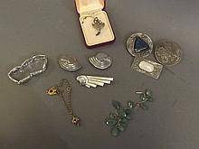 Two pewter brooches set with stones, another with a lion, an Art Deco style earring and brooch set with a silver metal bracelet, another set with stones, a Victorian pinchbeck charm bracelet, and a silver and marcasite brooch