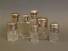 A collection of seven Hallmarked silver topped cut glass jars, 4½'' high