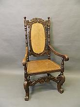 A good C19th carved oak Carolean style elbow chair with bergere seat and back