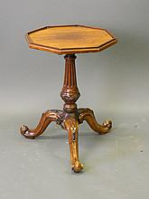 A Georgian style mahogany octagonal wine table on a well carved tripod base, 15'' x 21½''