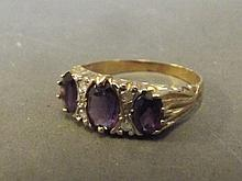A 9ct gold three stone amethyst and diamond ring,