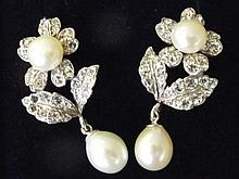 A pair of 9ct gold & silver earrings set with