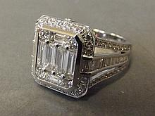 An 18ct white gold large baguette set ring, size M