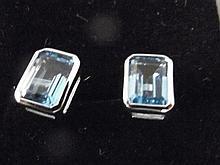 A pair of 9ct white gold emerald cut blue topaz