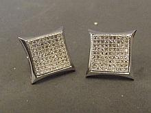 A pair of 9ct white gold large pave diamond square