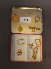 An 18ct gold pierced pendant, an 18ct gold bar brooch, an antiques gold snake ring (AF), gold bracelet etc