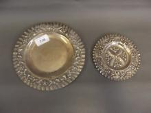 An 800 mark silver dish decorated in relief, 5'' diameter, and another larger, 310g