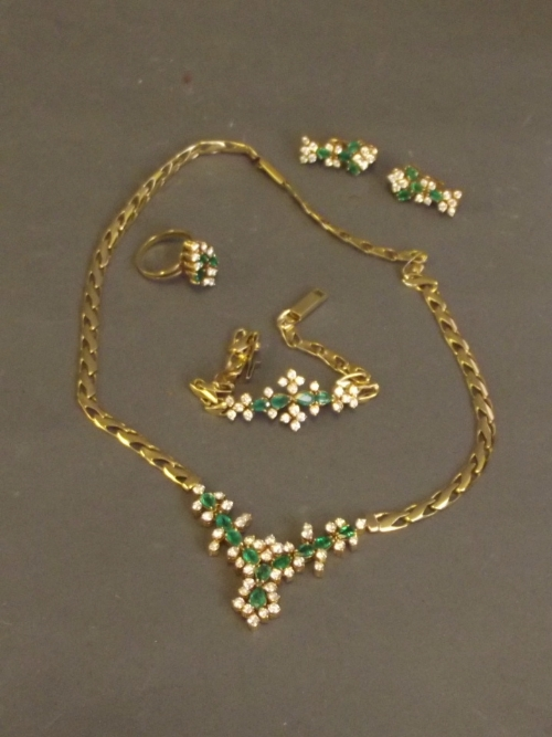 An 18ct gold suite of emerald and diamond jewellery to include a bracelet, earrings, necklace and ring