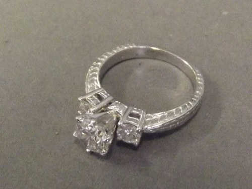 A platinum set three stone diamond ring with central stone 2.2ct