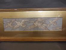 An Oriental framed embroidery of flying cranes, 32'' x 7''