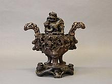 A late C19th Chinese soapstone censer, the base carved with dragons, the ce