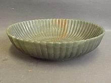 A Chinese marbled spinach jade Mughal style bowl with carved foliate decora