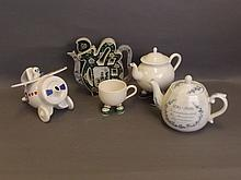 A Chinese pierced and shaped teapot, an aeroplane teapot, an 'American Revo