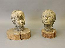 A pair of composite stone casts, busts of a boy and girl, on wood mounts, 1
