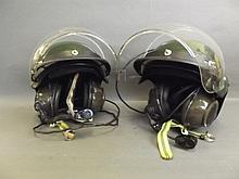 Two military helmets with Racal Acoustics intercom, 9'' high