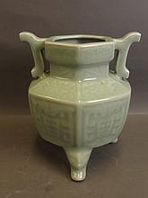 A Chinese celadon glazed pottery censer with raised archaic style decoratio