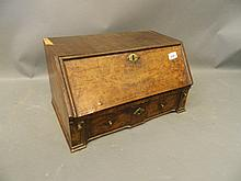 An C18th burr walnut toilet mirror/desk cabinet, the fall front opening to