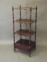 A Victorian shaped front rosewood whatnot with single drawer and four tiers
