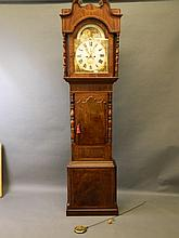 An early C19th Lancashire inlaid figured mahogany longcase clock with arche