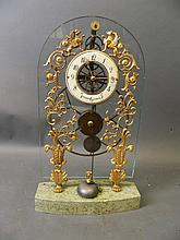 An ormolu and glass skeleton clock, the painted enamel dial inscribed 'Hugu