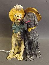 A cold painted bronze figure of two dogs, 7'' high