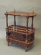 A Victorian burr walnut canterbury with pierced fret carved sides and singl