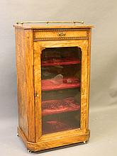 A Victorian inlaid figured walnut music cabinet with canted corners and thr