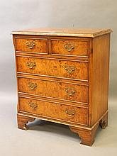 A small inlaid burr walnut chest of two over three drawers, with pierced br