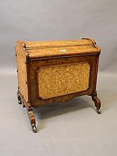 A Victorian inlaid burr walnut Canterbury with inset panel and shaped lift