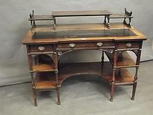 A late C19th Aesthetic Movement style rosewood kneehole desk of three drawe