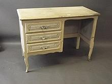 A painted oak kneehole desk with three drawers on shaped supports, 19'' x 4
