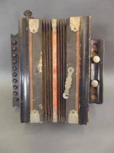 A small vintage concertina with ten keys and three buttons, 9½