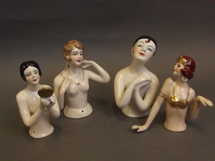 Four porcelain pin cushion dolls in the form of