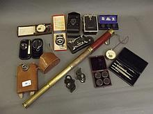 A box of ophthalmic lenses, cameras, telescope and
