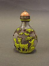 A Chinese carved Peking glass snuff bottle