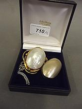 A large pinchbeck and Mother of Pearl brooch, and