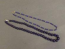 A lapis lazuli beaded necklace, and another