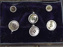 A set of Abalone set button cufflinks and studs in