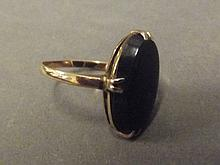 A 9ct gold ring set with an oval bloodstone, size