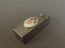 A Continental silver lipstick holder and mirror