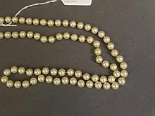 A long string of cultured pearls, 30