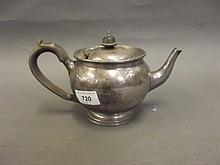 An early 20th Century Hallmarked silver teapot,