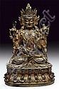 A cold-gilt bronze figure of Padmapani