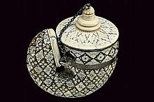 An inlaid powder-flask