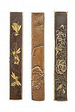 A lot of three kozuka grips