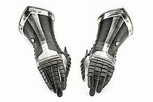A pair of black & white gauntlets