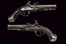 A pair of flintlock pistols by P. Girard
