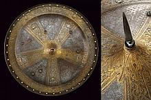 A rare gilded buckler decorated in-relief