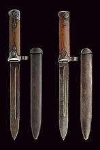 A lot of two 1938 model folding bayonets